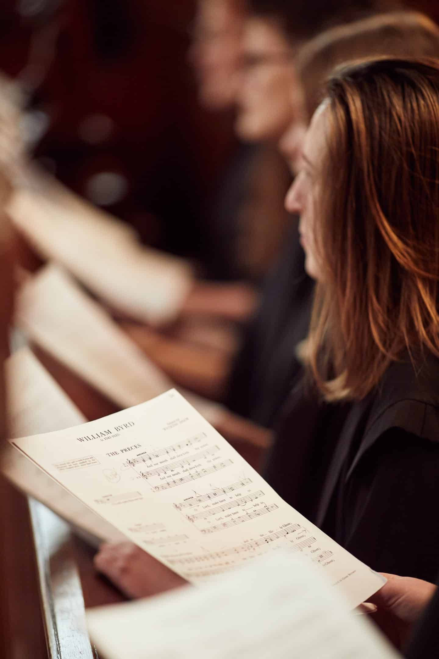 Choir member with music sheet in the Chapel