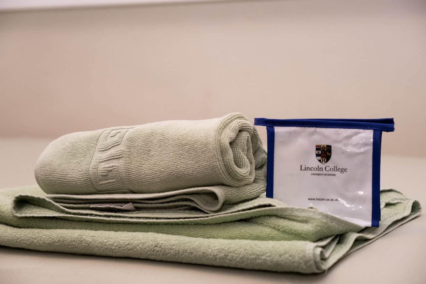 Towel and toiletries in a student guest room